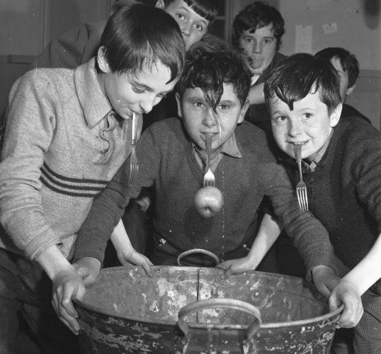 The Tweedie Memorial Boy's Club Hallowe'en party showing boys dookin' for apples in 1967.